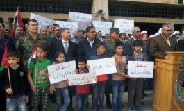 وقفة في حمص حداداً على أرواح شهداء كفريا والفوعة